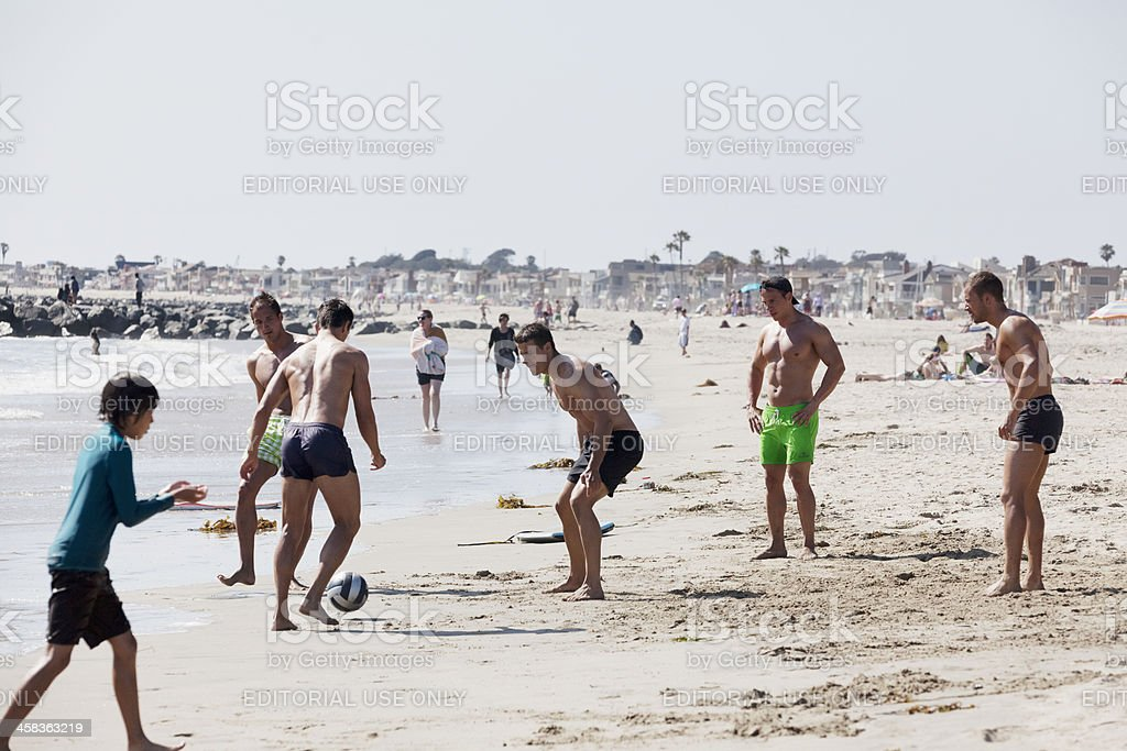 Playing soccer at the beach royalty-free stock photo