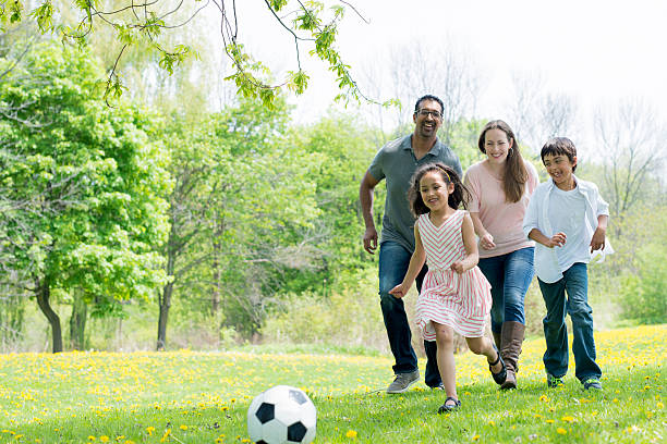 Playing Soccer at the Park stock photo
