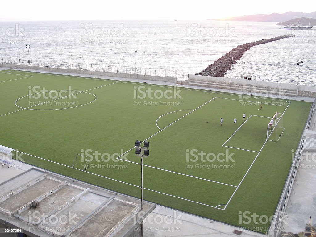 Playing Soccer by the Sea royalty-free stock photo