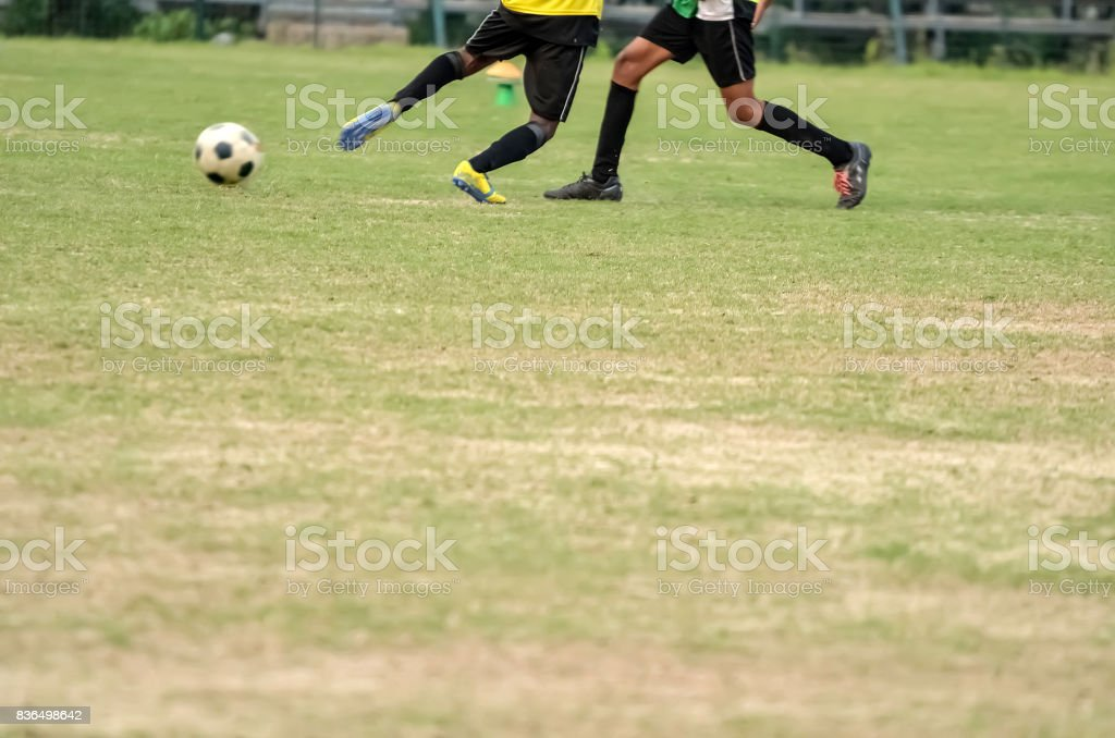Playing soccer match stock photo