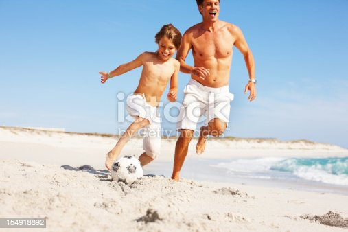 829627936istockphoto Playing soccer on the beach 154918892