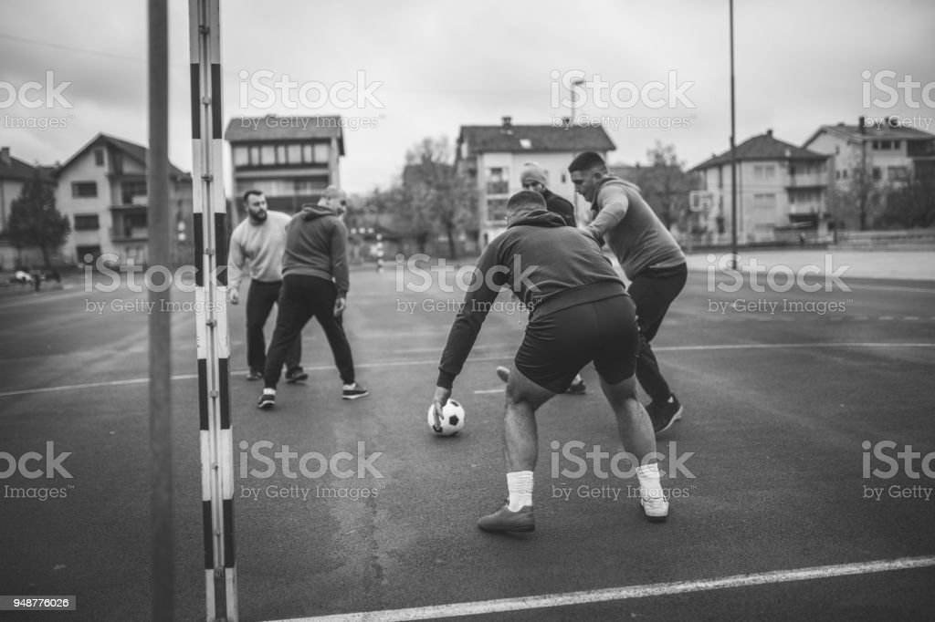 Playing soccer outdoors stock photo