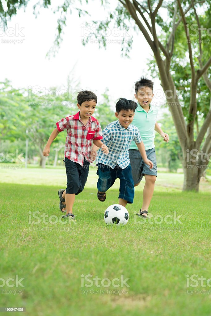 Playing soccer stock photo