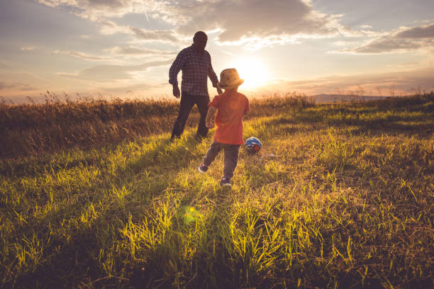 playing soccer - rural lifestyle stock photos and pictures
