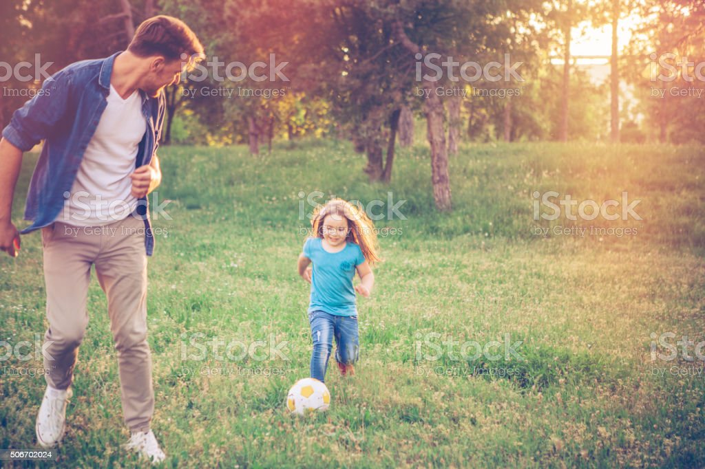 Playing Soccer with dad stock photo
