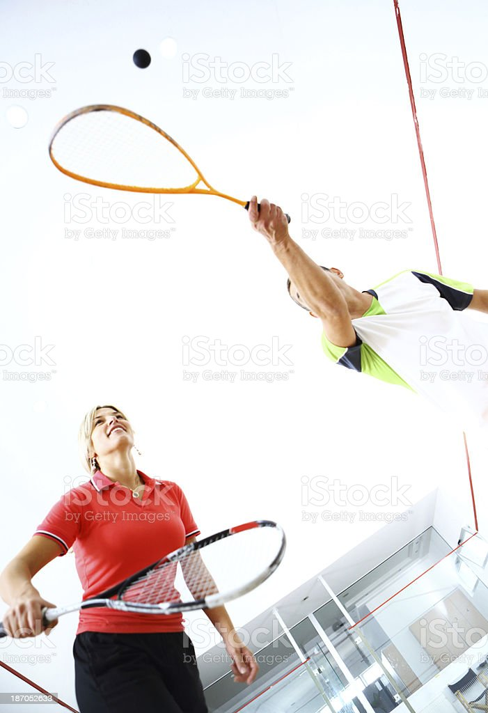 Playing squash. stock photo
