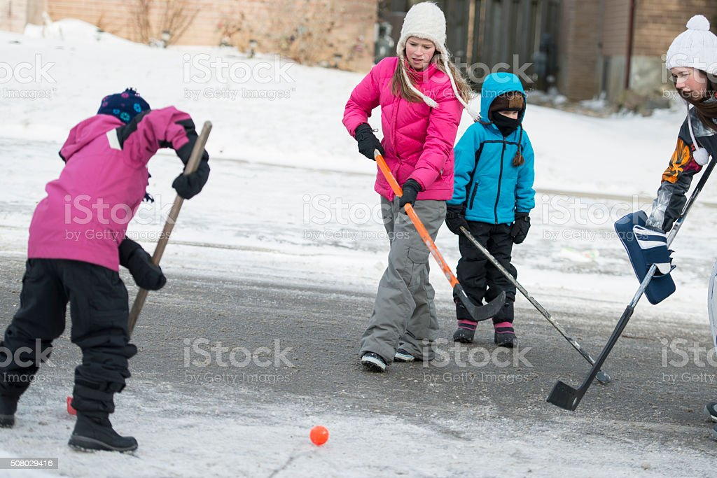 Playing Street Hockey on a Winter Day stock photo