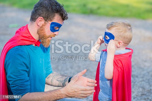 516318379 istock photo Playing Superheroes 1167278841