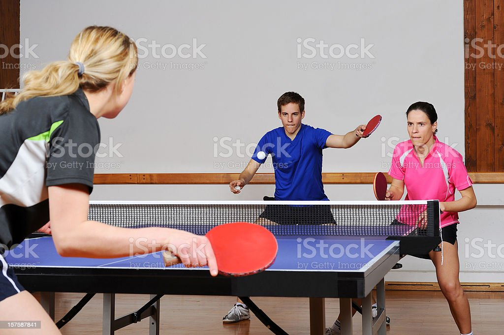Playing table tennis mixed doubles stock photo