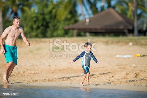 605742160 istock photo Playing Tag at the Beach 533430922
