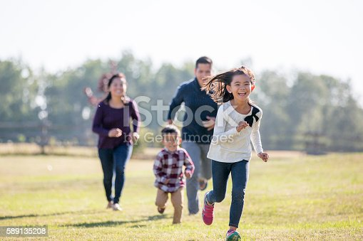 589135214 istock photo Playing Tag at the Park 589135208