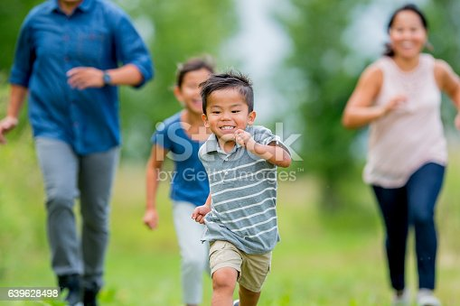589135214 istock photo Playing Tag at the Park 639628498