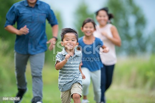 589135214 istock photo Playing Tag Outside on a Sunny Day 598162638