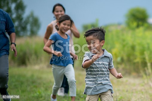 589135214 istock photo Playing Tag Outside 624695756
