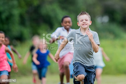 istock Playing Tag Outside 654902742