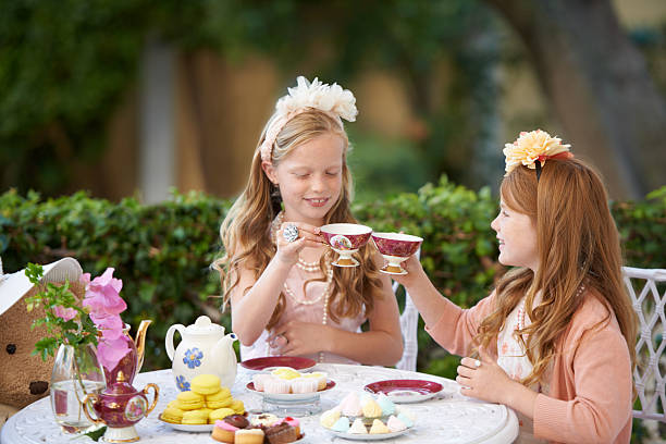 Playing tea party is fun stock photo