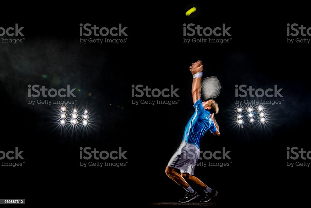 Playing tennis at court stock photo
