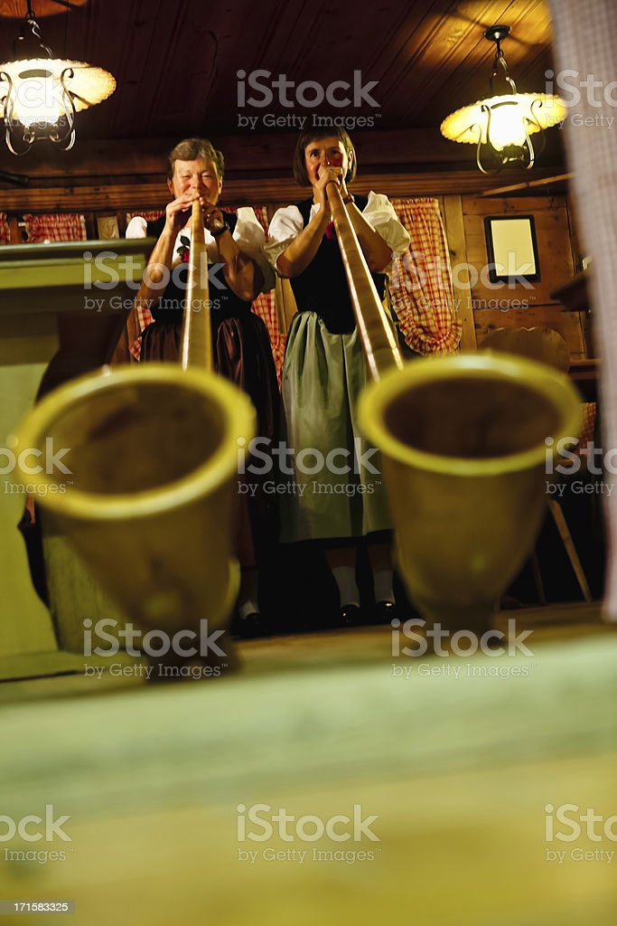 Playing the Alpenhorns stock photo