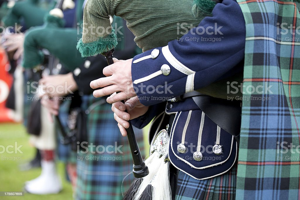 Playing the Bagpipes in a Marching Band stock photo