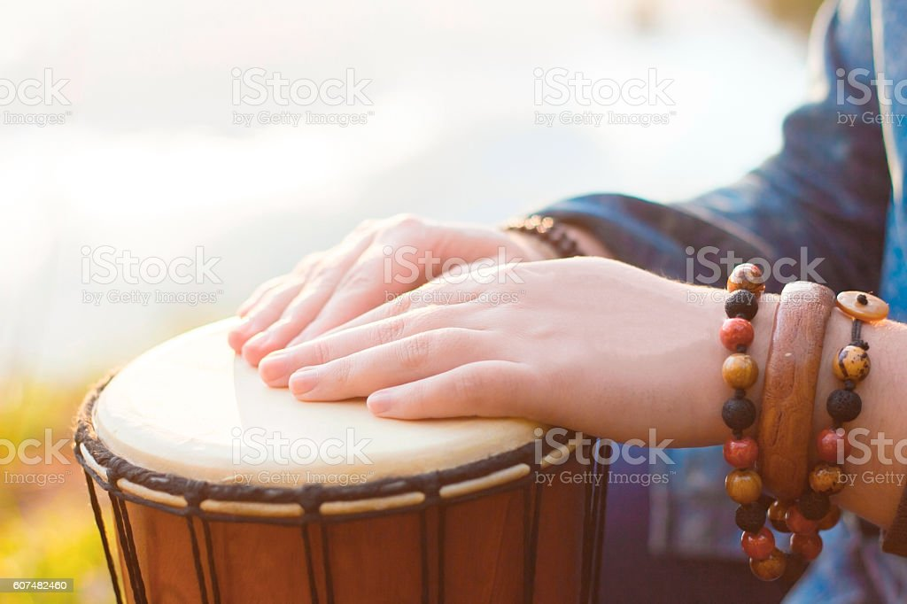 Playing the djembe stock photo