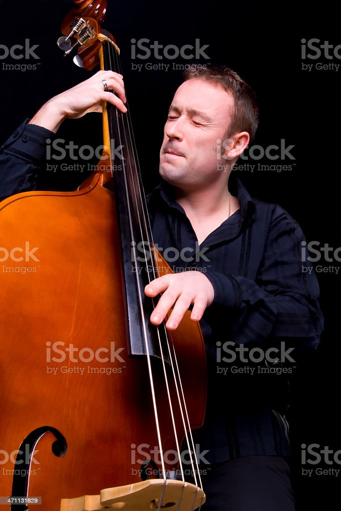 Playing the double bass stock photo