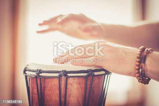 Cut out of hands which are playing the drums.