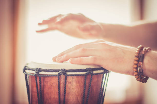 Playing the drum. Cut out of male's hands which are playing in the rhythm. Cut out of hands which are playing the drums. drum percussion instrument stock pictures, royalty-free photos & images