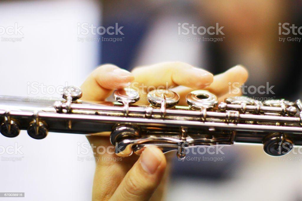 playing the flute stock photo