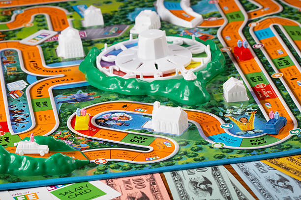 playing the game of life - game of life stock photos and pictures