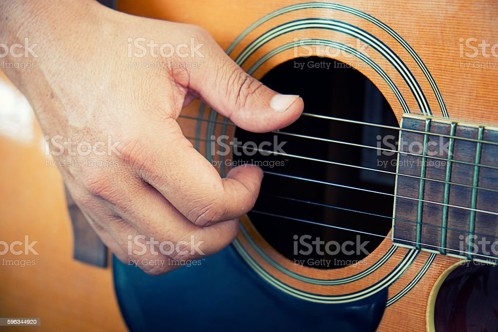 playing the guitar vintage effect. stock photo