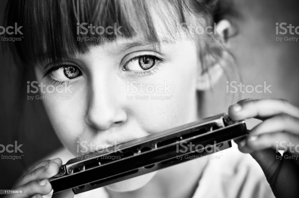 Playing the harmonica royalty-free stock photo