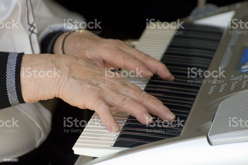 Playing the keyboard stock photo