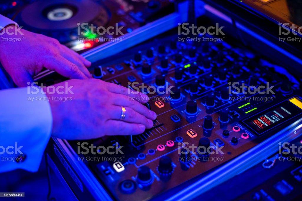 DJ playing the mixer stock photo