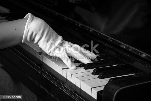 Playing the piano in gloves