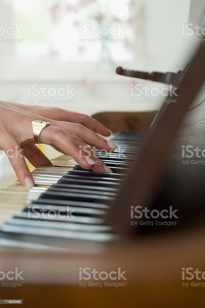 Playing the piano royalty-free stock photo