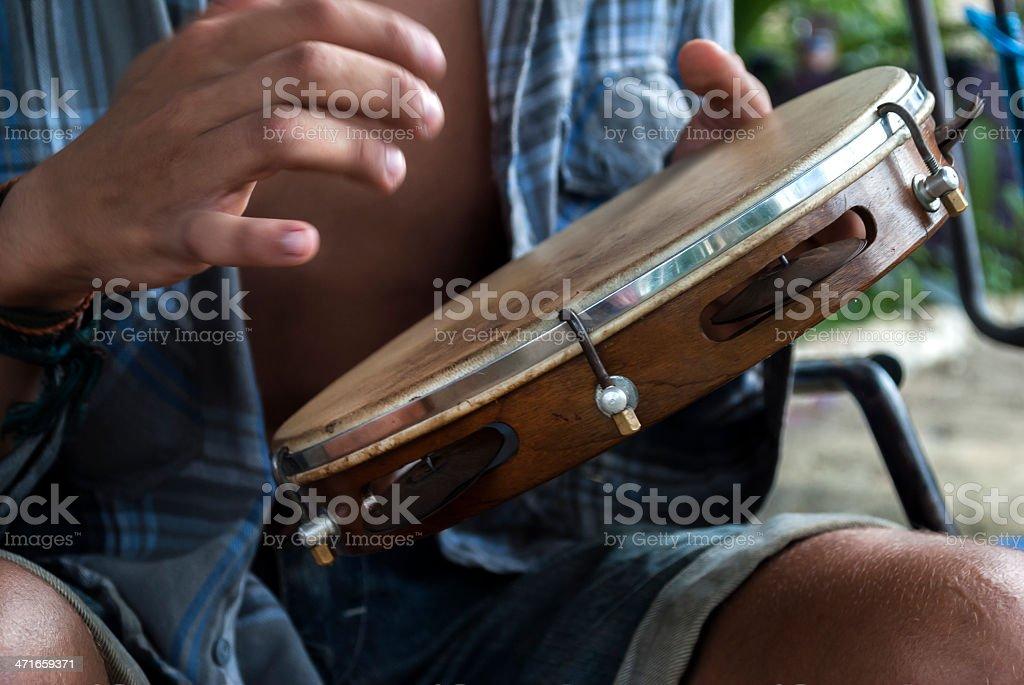 Playing the Tambourine stock photo