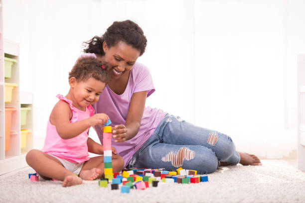 playing time with mommy. - defection stock photos and pictures