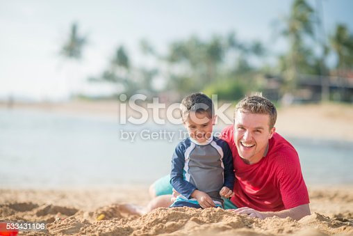 605742160 istock photo Playing Together in the Sand 533431106