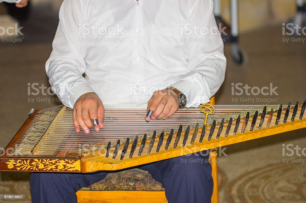 Playing turkish zither, kanun stock photo