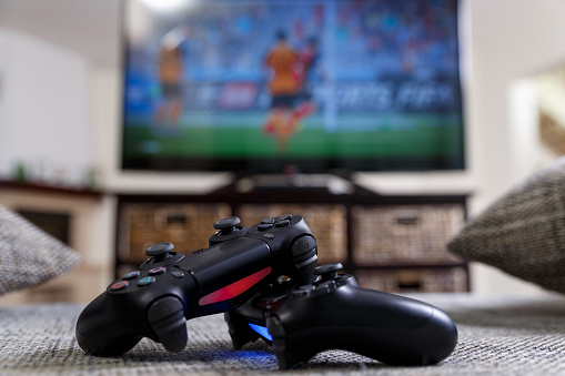 Playing Video Game Console Controllers Stock Photo - Download Image Now