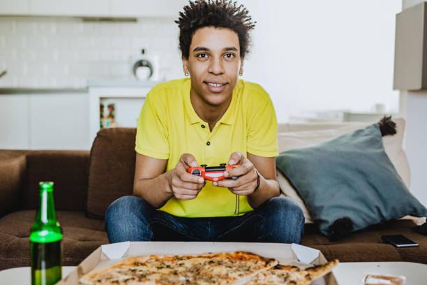 playing video games - man joystick imagens e fotografias de stock