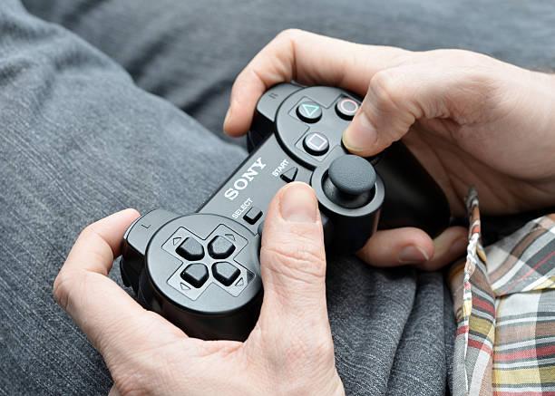 playing video games - playstation stockfoto's en -beelden