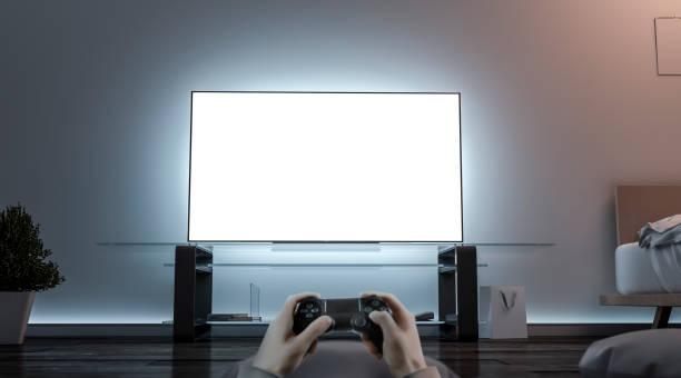playing videogame with joystick near blank white tv screen mockup - man joystick imagens e fotografias de stock