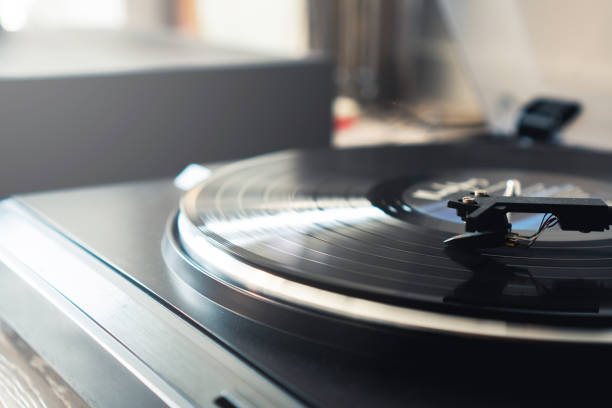 Playing vinyl records stock photo