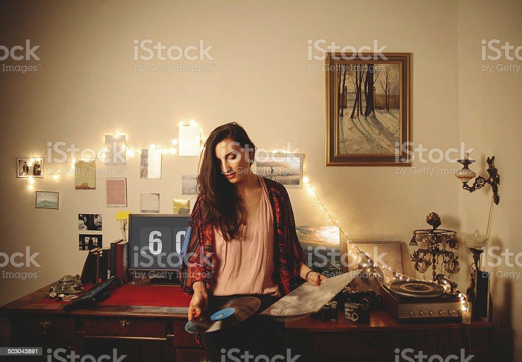 Playing vinyl records stock photo