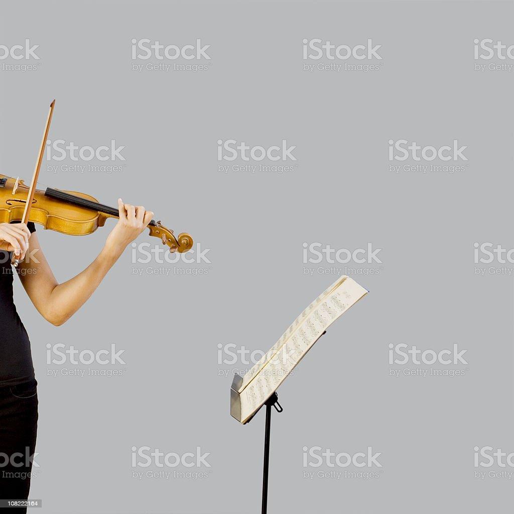 Playing violin stock photo