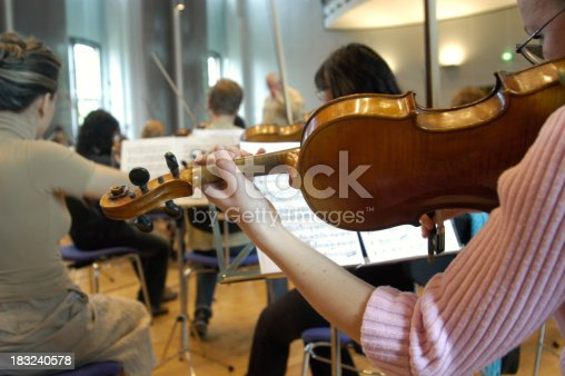 Girl playing her violin in a rchestra