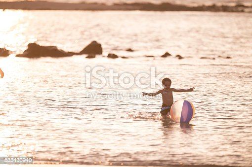 605742160 istock photo Playing with a Beach Ball in the Ocean 533430940