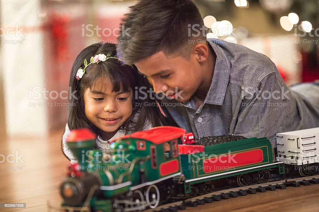 Playing with a Christmas Train stock photo