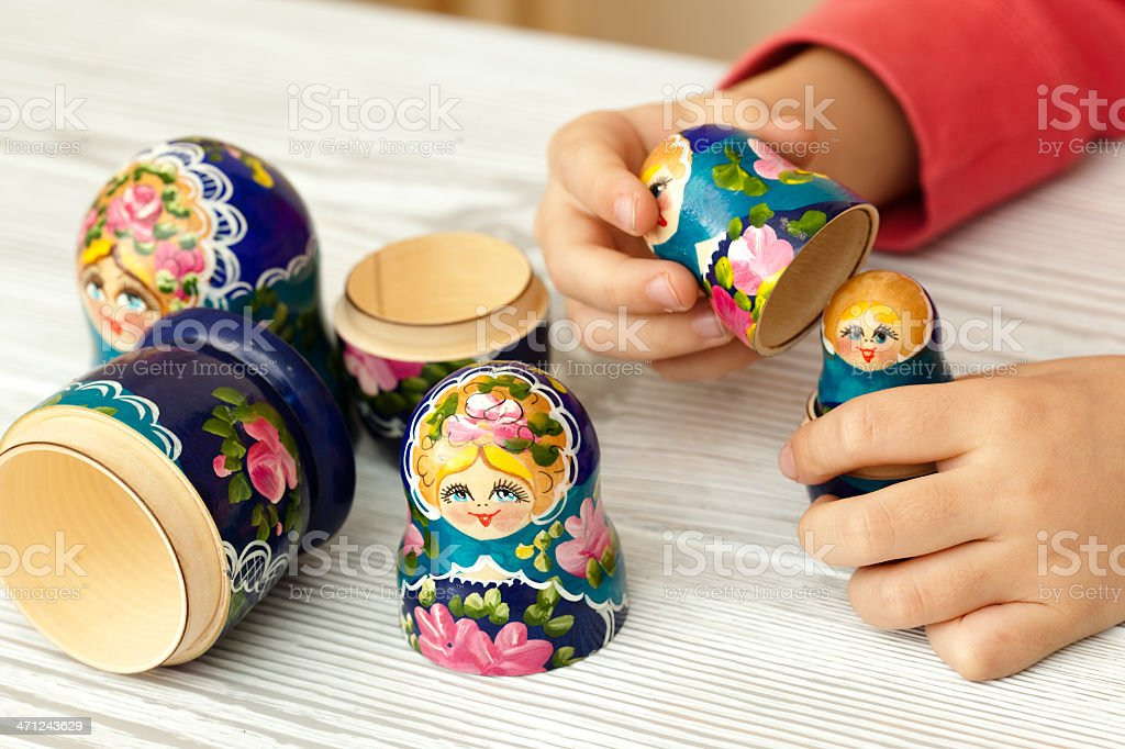 Playing with a matrioshka royalty-free stock photo